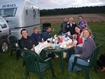 Some of the group who stayed on Saturday night (and helpers) enjoying the barbeque in the evening sun at Kelsall Hill - Pat Guerin