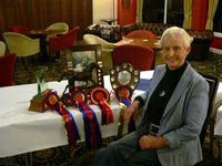 Mary Korn with her collection of trophies