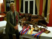 Anna Collins with her collection of trophies